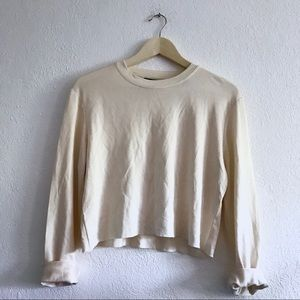 Cream silky cropped long sleeve top